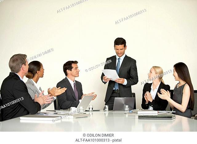 Businesspeople applauding at meeting