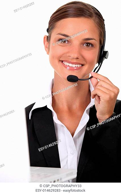 Receptionist with headset and computer