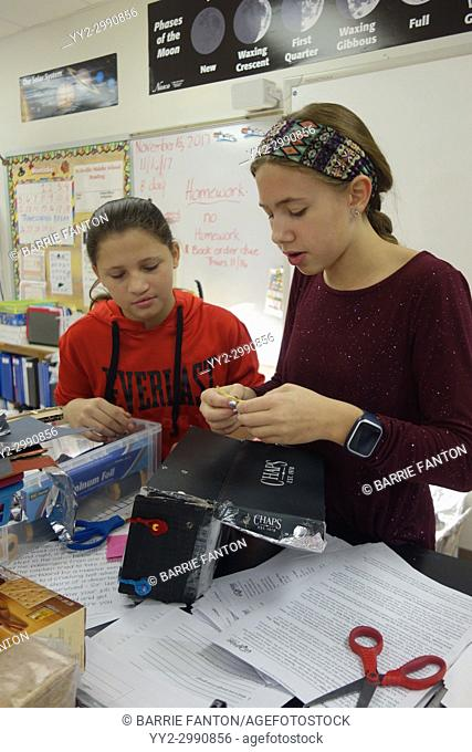 6th Grade Girls Building Solar Oven in Science Class, Wellsville, New York, USA
