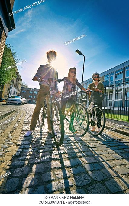 Women in urban area with bicycles