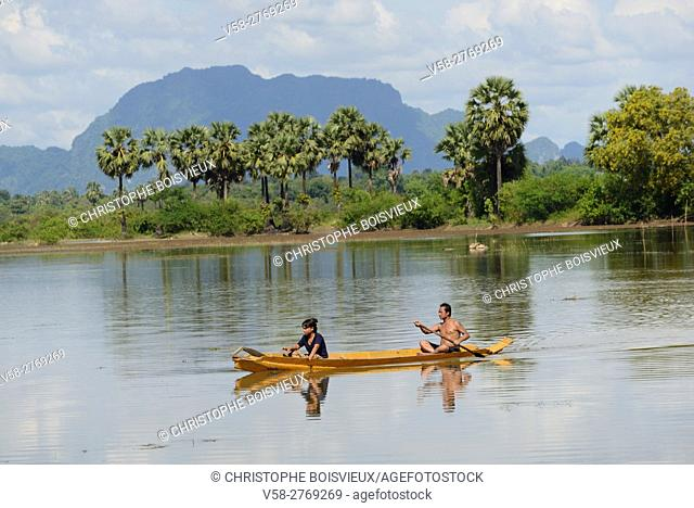 Myanmar, Kayin (Karen) State, Hpa-An region, Boating on flooded paddy fields