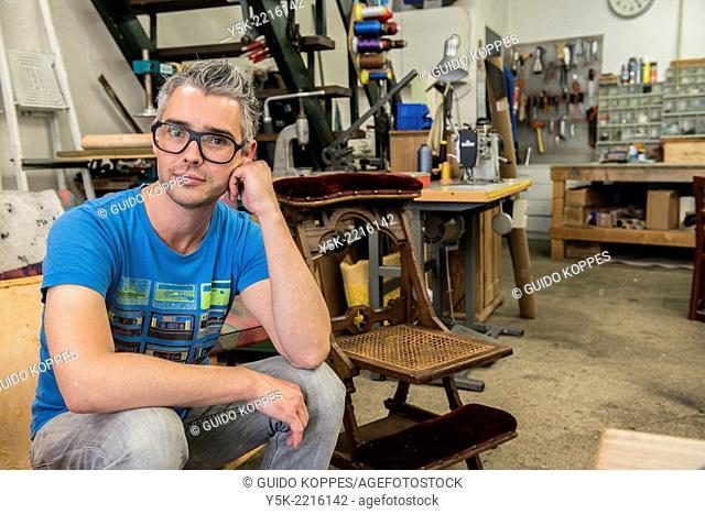 Tilburg, Netherlands. Josef is an apprentice upholsterer, soon taking over the workshop from the 72 year old upholsterer 'Boy'