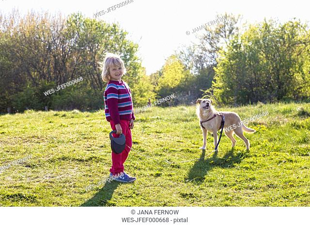 Little girl walking the dog