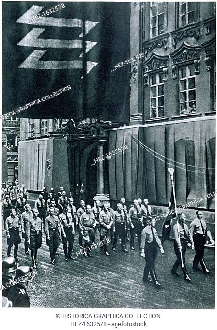 Hitler and Goering leading a rally through Munich on Martyrs' Day, 9th November, 1935. From Deutsche Gedenkhalle: Das Neue Deutschland compiled by General Von...