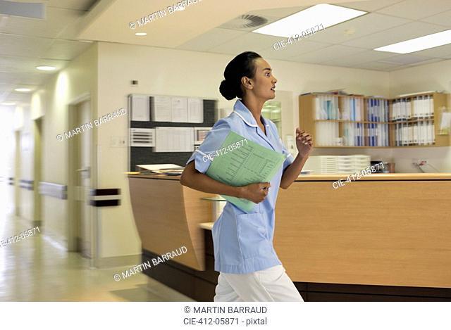 Nurse rushing in hospital hallway
