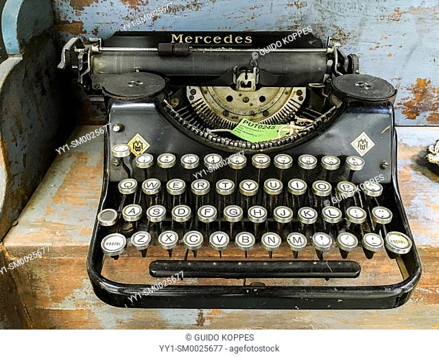 Tilburg, Netherlands. A vintage, mechanical typewriter, branded: 'Mercedes' inside a retrospective collection of industrially produced products