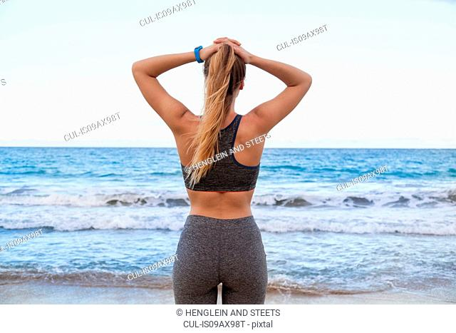 Rear view of young female runner on beach, Dominican Republic, The Caribbean