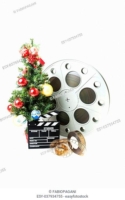 Christmas tree with red gold and blue balls, cinema big reel and movie clapperboard on white background vertical frame