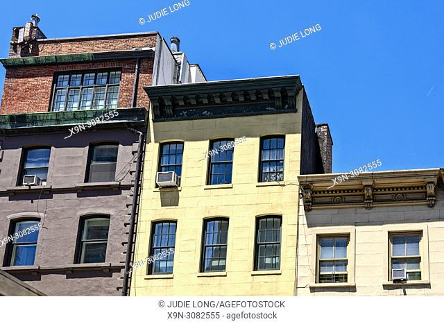 New York City, Manhattan. Looking up at Three Tenement Buildings of Varying Height