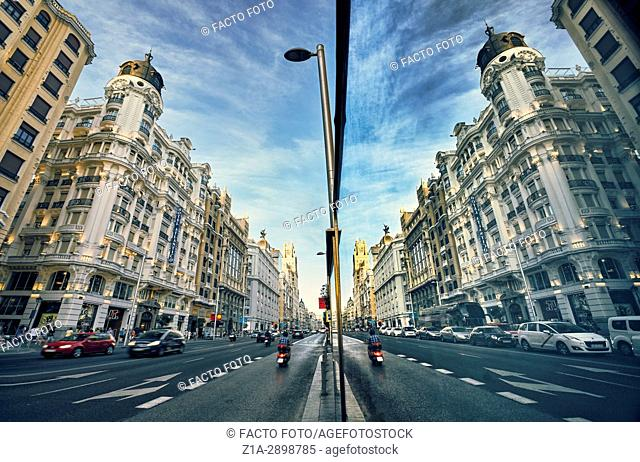 Reflection on a window in Gran Via Avenue. Madrid. Spain