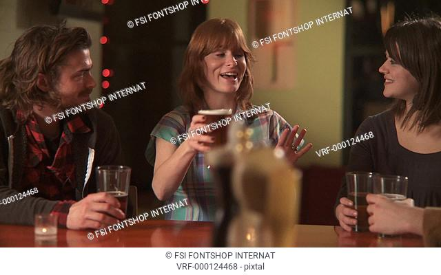 CU, PAN, Four friends sitting at a bar drinking beers when one woman proposes a toast