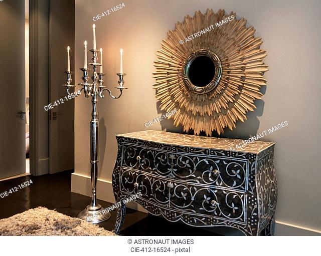 Elegant dresser, mirror and candelabra in luxury bedroom
