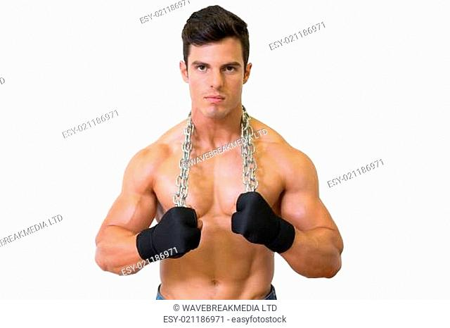 Portrait of a serious shirtless young muscular man