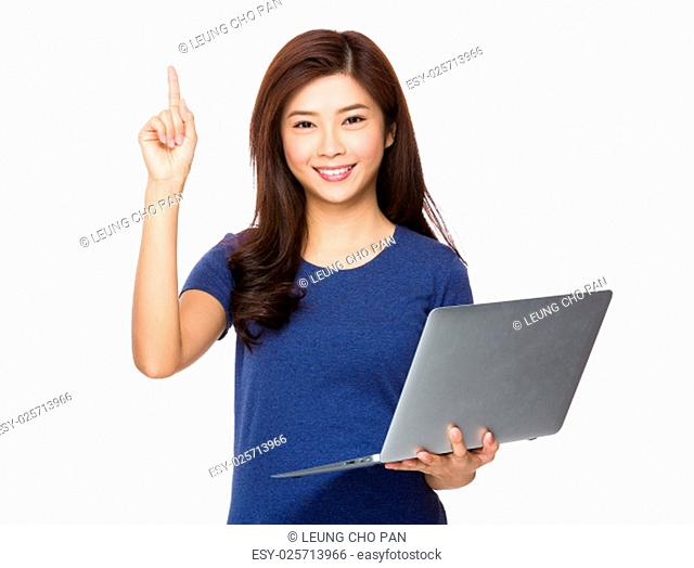 Young woman hold with laptop computer and finger pointing up