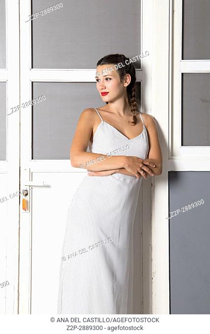 Mid-adult woman in white dress