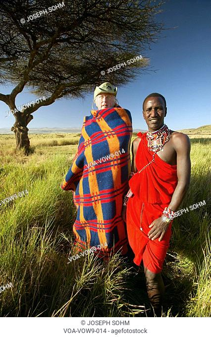 Peter Bender in Senior Elder robe and Masai warrior standing near Acacia Tree in the Lewa Conservancy of Kenya Africa