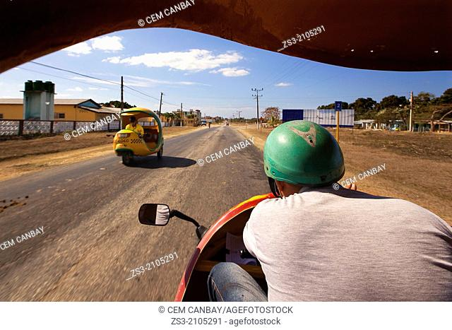 Coco Taxi driving at Peninsula Ancon; Trinidad, Sancti Sp'ritu Province, Cuba, West Indies, Central America