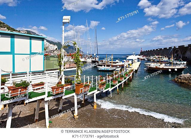 Boats in the harbour and a view of the town of Amalfi on the Gulf of Salerno in southern Italy