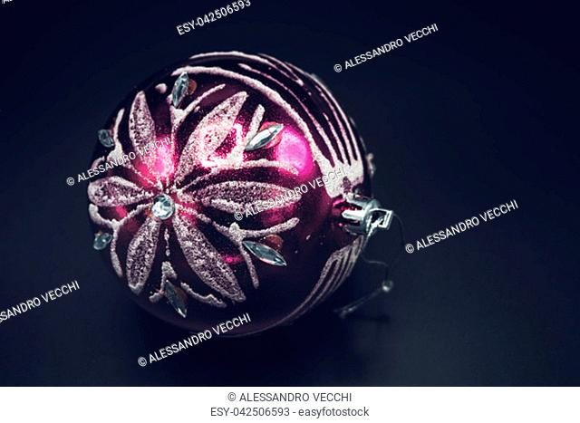 Christmas wallpaper background of pink and silver celebration tree ball isolated on black background
