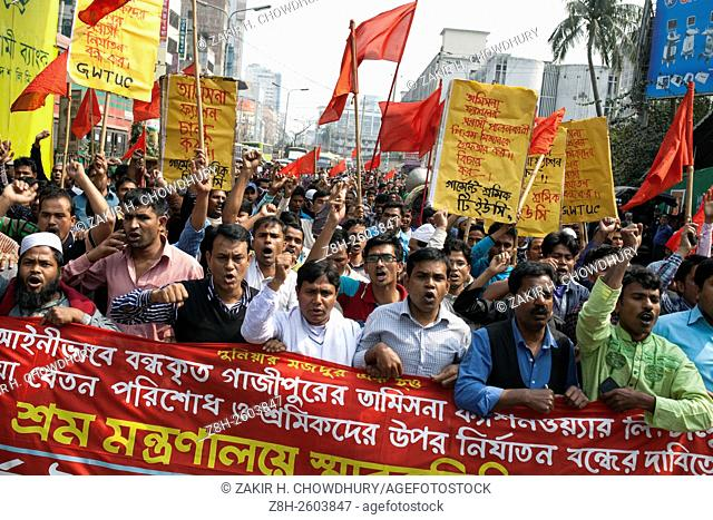 DHAKA, BANGLADESH - FEBRUARY 04 : Workers of Tasmina Fashionware Limited made made procession and rally in front of Press Club demanding their due wages and to...