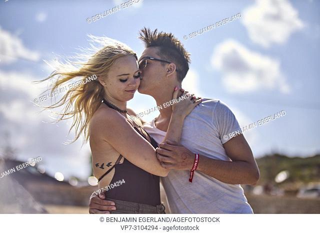 Greece, Crete, Chersonissos, couple kissing outdoors, sunny weather