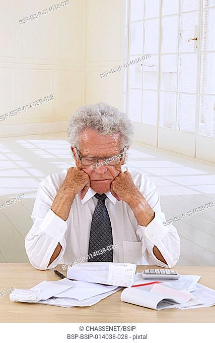 Senior man doing paperwork
