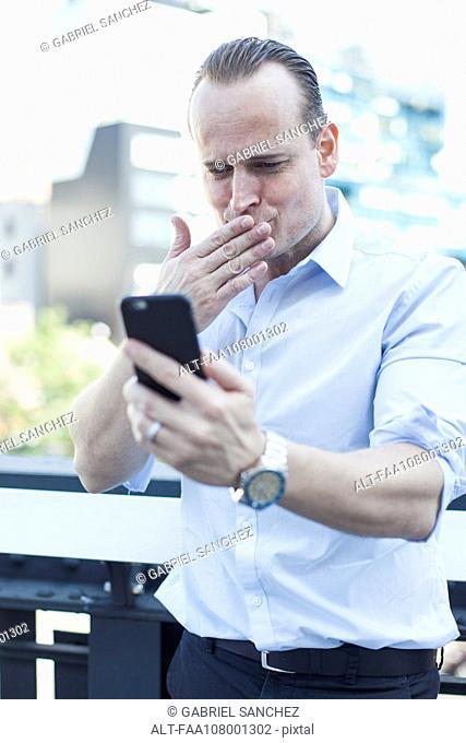 Man blowing a kiss at smartphone