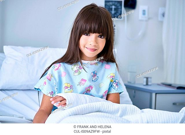 Portrait of girl patient with arm plaster cast in hospital children's ward