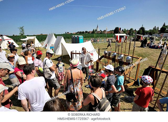 France, Nord, Bouvines, Medieval Festival of Bouvines 2013, audience listening to explanations of weapons of knights