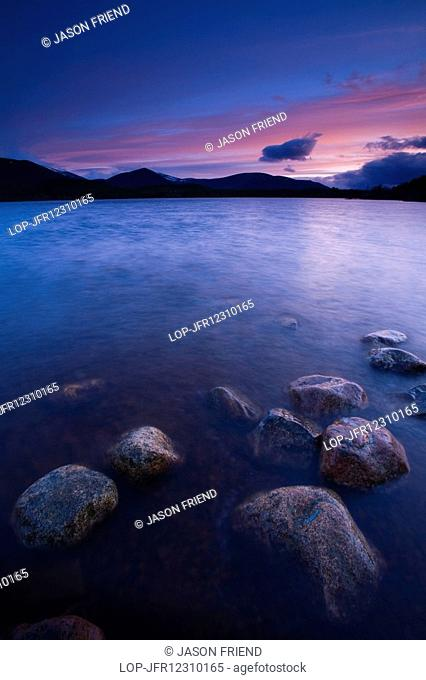 Scotland, Highland, Loch Morlich. Deep red clouds above Loch Morlich and the surrounding mountains in the Cairngorms National Park