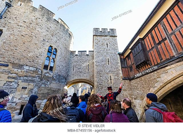 England, London, Tower of London, Beefeater and Tour Group