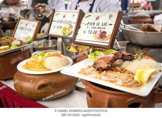 "Peruvian food dishes: """"Pato al Aji"""", """"Aji de Gallina"""". Peruvian seasoning and flavor, food fair. La Limeñita boulevard, Camana Street"