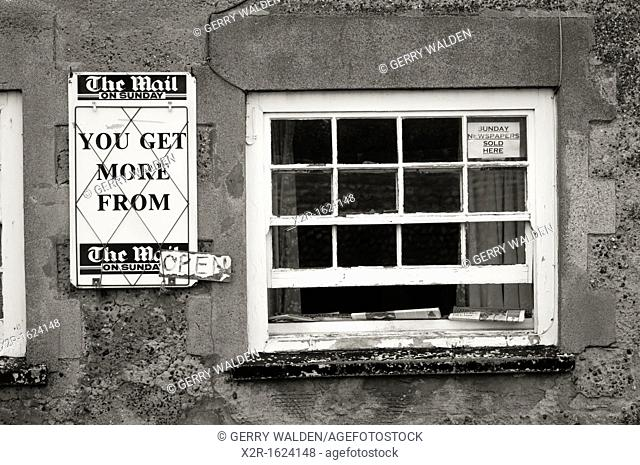 Small newsagents shop run from domestic house front room in the village of Cley Next The Sea in Norfolk, England