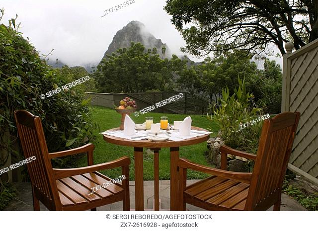 Belmond Sanctuary Lodge - Hotel in Machu Picchu, Peru. Breakfast prepared in the back garden of one of the rooms at Machu Picchu Sanctuary Lodge