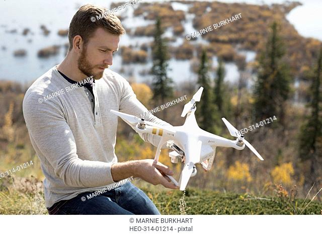 Man with drone on hilltop