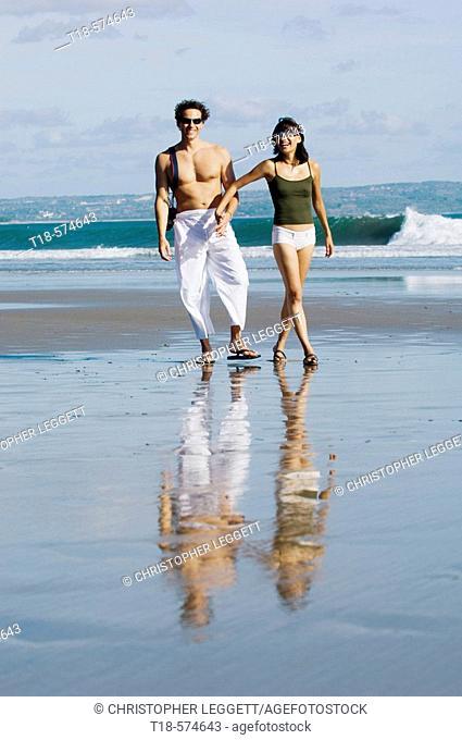 couple sightseeing on beach