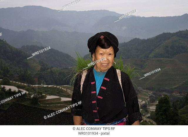 China, Guangxi Province, Guilin. Longsheng terraced ricefields. Woman of Dong mountain tribe