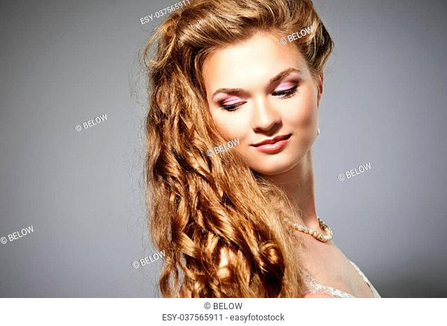 Portrait of beautiful long haired blonde woman