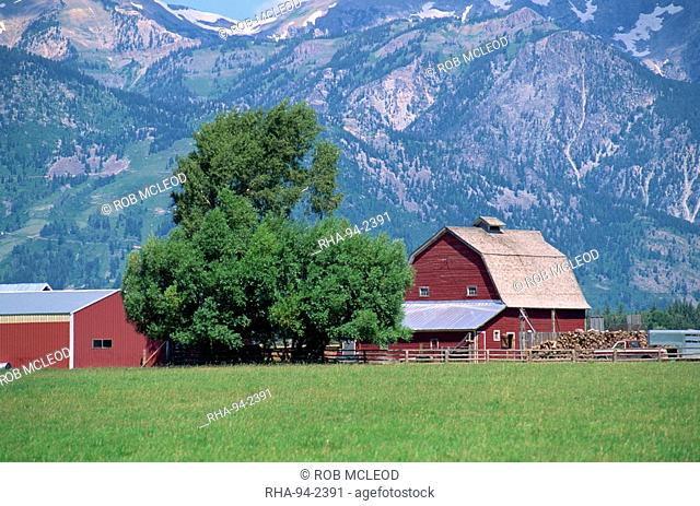 Farm buildings with mountain slopes behind, Jackson Hole, Wyoming, United States of America, North America