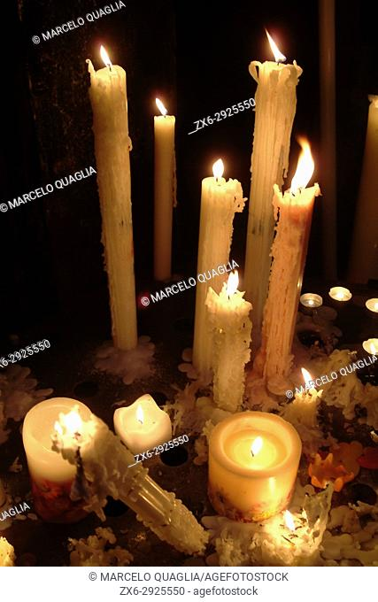 Candles inside benedictine Monastery of Montserrat. Montserrat Natural Park, Bages region, Barcelona province, Catalonia, Spain