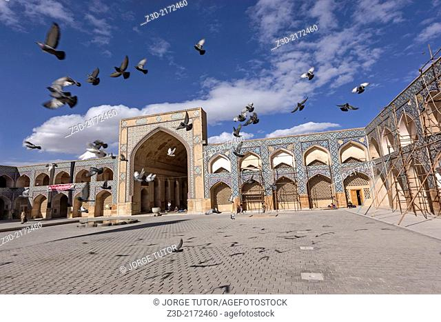 Doves flying in the Jameh Mosque, Isfahan, Iran