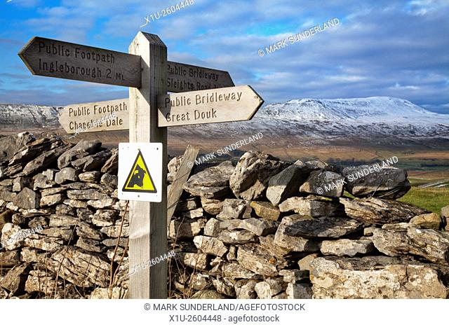 Public Footpath Signpost at Southerscales with Whernside in the Distance Chapel le Dale Yorkshire Dales England