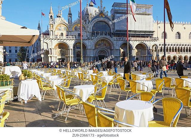 St Mark's Square crowded with tourists and alfresco cafe seating, Venice, Veneto, Italy, Europe