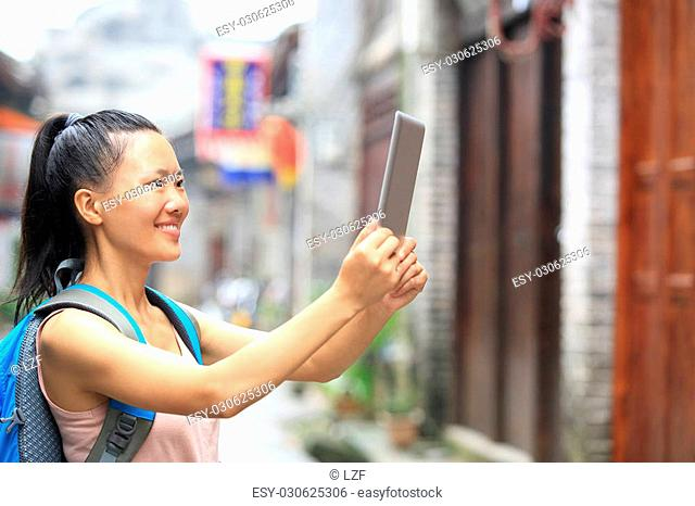 young asian woman tourist hold blank digital tablet