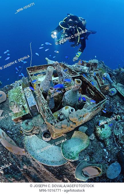 Scuba diver views artifact display on Japanese shipwreck Shinkoku Maru, Chuuk, Micronesia, Pacific