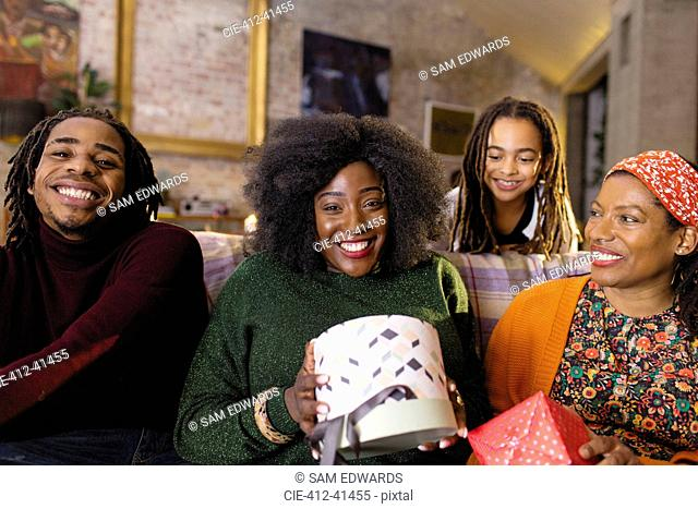 Portrait smiling, happy family opening Christmas gifts