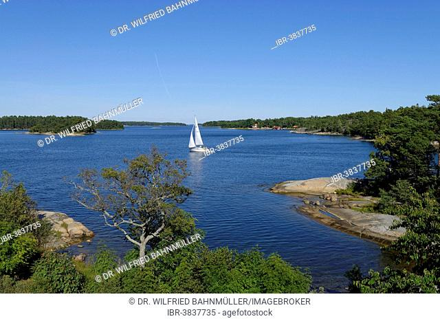 Sailboat and typical round polished rocks, roches moutonnées, on Finnhamn Island in the Stockholm Middle Archipelago, Stockholm, Sweden
