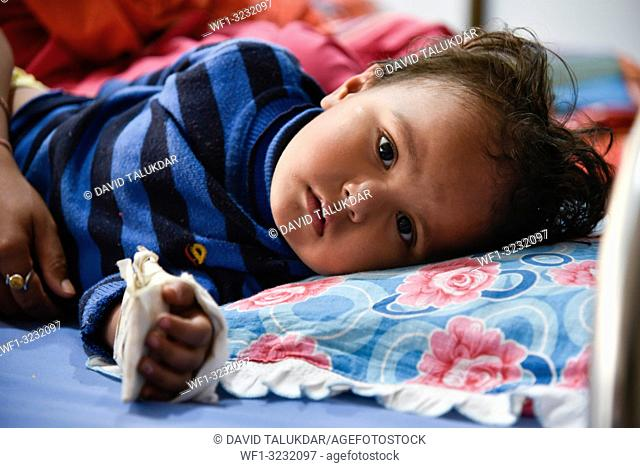 World Cancer Day. Guwahati, Assam, India. 4 February 2019. Child Cancer patient on a bed at Dr. Bhubaneswar Borooah Cancer Institute and research centre in...