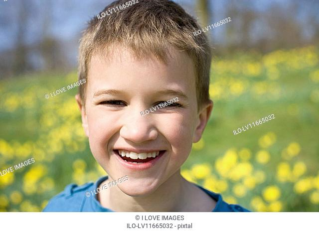 A portrait of a young boy smiling