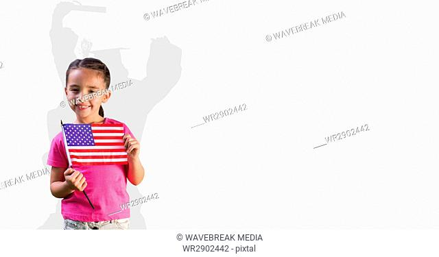 Digital composite image of little girl holding American flag with graduate shadow in back